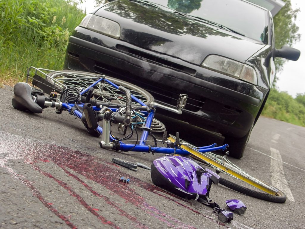 Arranged scene of bicycle accident on the road